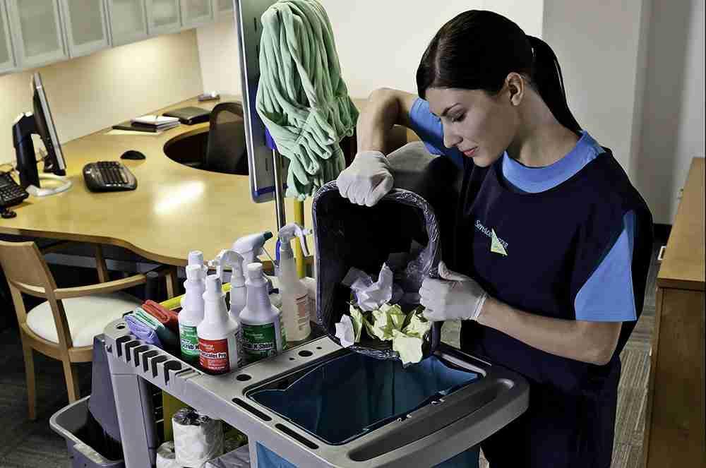 ServiceMaster's Women Emptying Trash Pretty